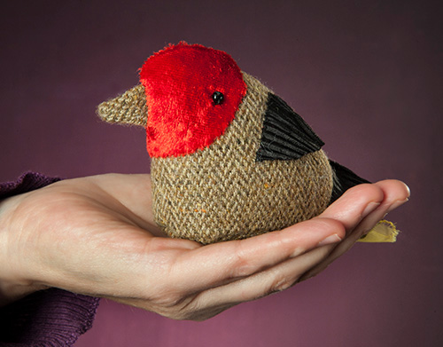 Bird puppet in sitting on a hand